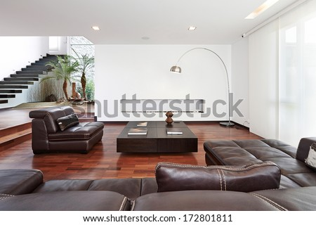 Interior design: Modern big living room with big empty white wall - stock photo