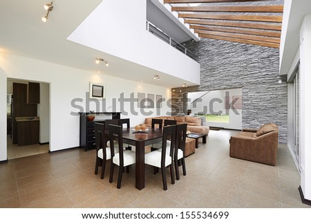 Interior design: Modern Living room with big empty white wall - stock photo