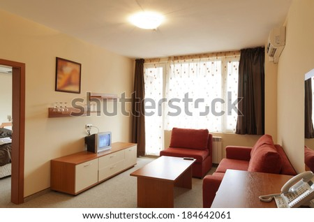 Interior Design: modern small hotel room with tv - stock photo