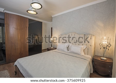 Interior design of a luxury apartment show home bedroom - stock photo