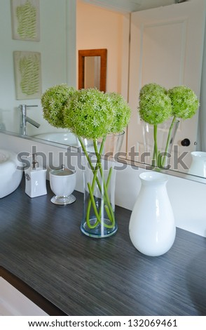 Interior design of a luxury bathroom with washbasin (sink) and some decoration on the counter - stock photo