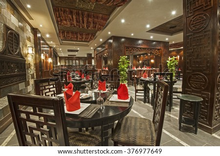 Interior design of a luxury hotel Asian restaurant dining area with ornate decor - stock photo