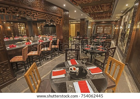 Interior design of a luxury hotel resort Asian restaurant dining area with ornate decor