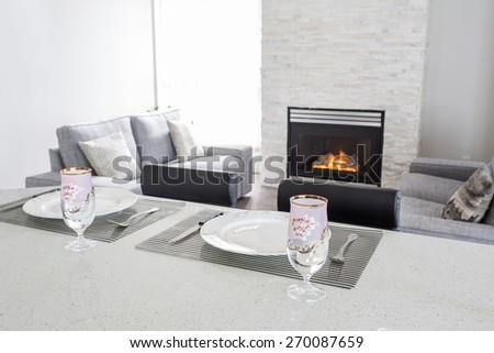 Interior design of a luxury living room with a gas fireplace. - stock photo