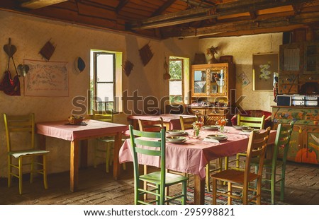 Interior design of an old Serbian restaurant, decoration and prepared table for lunch.