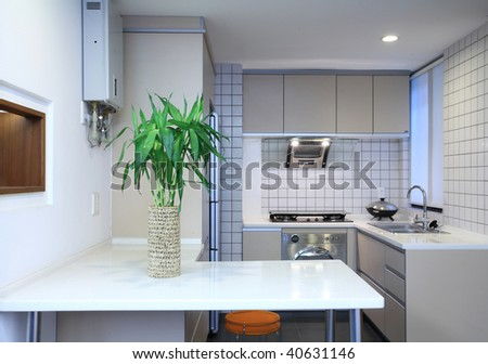 interior design of clean modern white and black kitchen with stainless steel equipment - stock photo