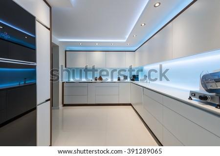 Interior design of clean modern white kitchen - stock photo