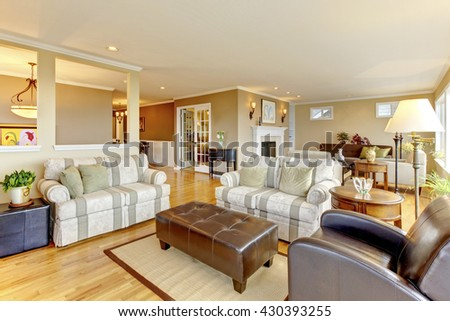 Interior design of cozy classic living room with hardwood floor - stock photo