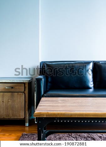 Interior design of empty modern room with black couch - stock photo