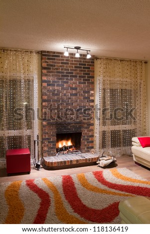 Interior design of living room in a new house with fireplace - stock photo