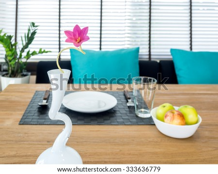 Interior design of modern dining table with breakfast and flower vase/ home improvement & decoration concept - stock photo