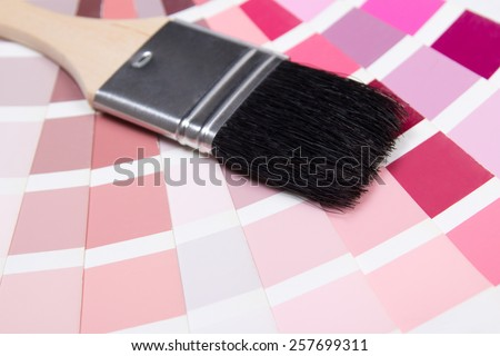 interior design - paint brush and colorful paper palette with red colors - stock photo