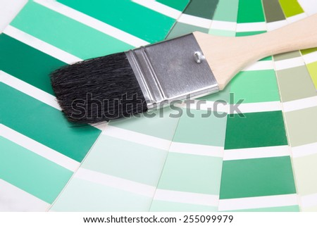 interior design - paint brush and colorful paper palette with vivid colors - stock photo