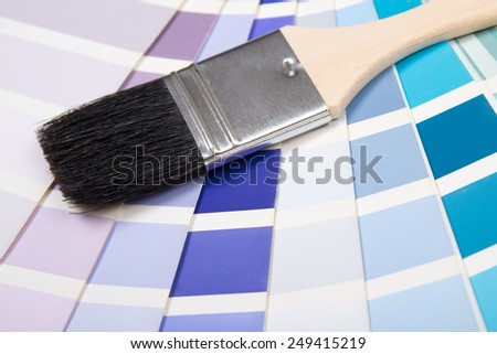 interior design - paint brush over colorful paper palette with vivid colors - stock photo