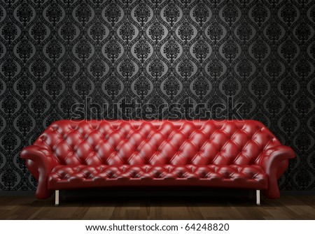 interior design scene of red leather couch on black wall illuminated from above by spotlight