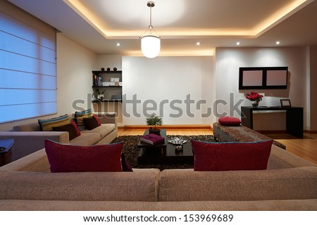 Interior design series: Modern living room with empty white wall - stock photo