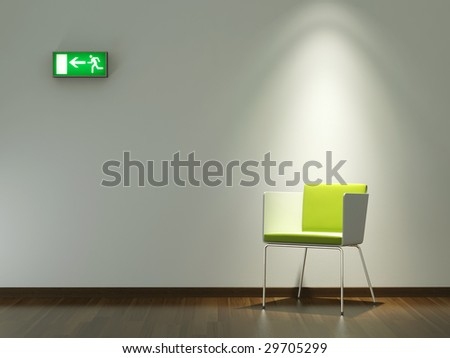 interior design white wall with modern chair under spotlight and exit emergency sign