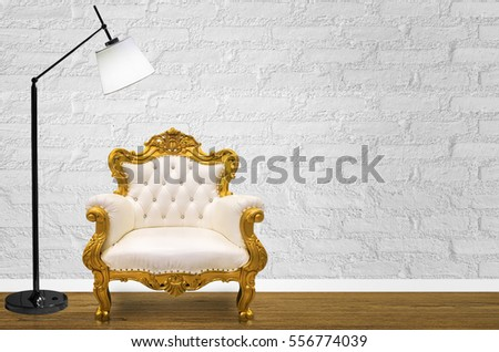 Interior design with Luxurious vintage style sofa on white wall.