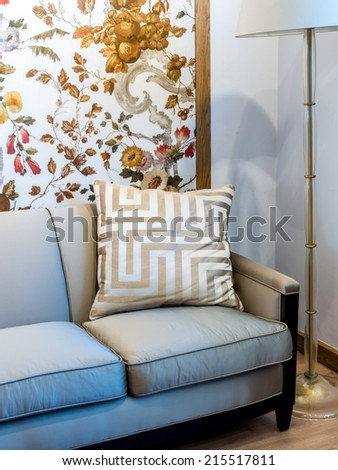 Interior design with luxury couch, cushion and lamp with wall covering background - stock photo