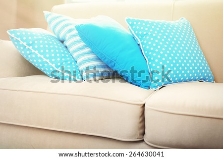 Interior design with pillows on sofa, closeup - stock photo