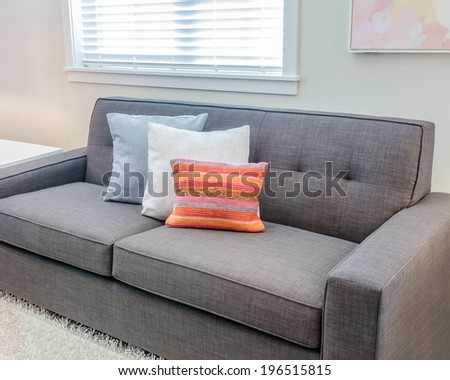 Interior design with sofa and colorful pillows - stock photo