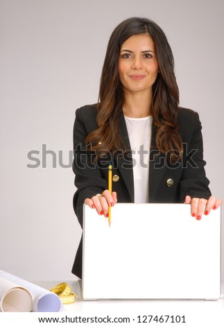 Interior designer and architect young woman working on computer. - stock photo
