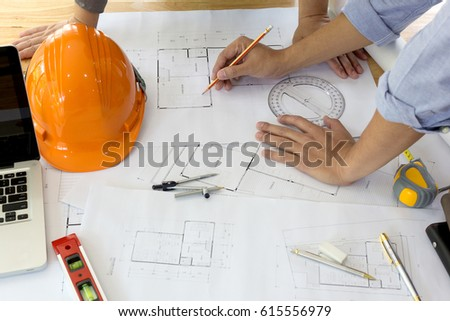 Interior Designer Discussing Data And Digital Tablet Computer Laptop With Business Document Graphics Design
