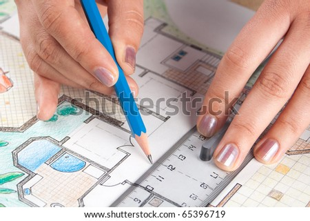 Interior designer draws a home floor plan - stock photo