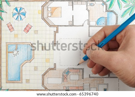Interior designer draws house floor plan - stock photo