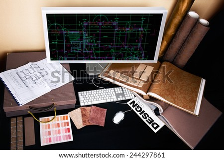 Interior designer's workplace. Architectural project on computer monitor, architectural plan, color swatches, tiles at the desk. - stock photo