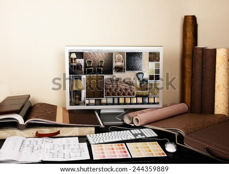 Interior designer's workplace. Architectural project on computer monitor, architectural plan, color swatches at the desk. - stock photo