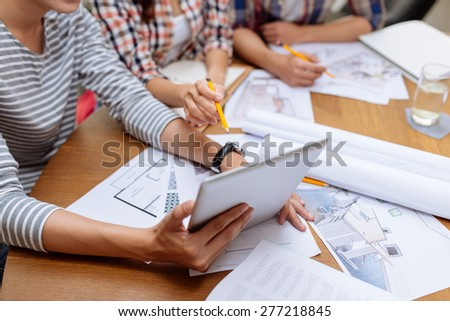 Interior designers using digital tablet at the meeting, selective focus - stock photo