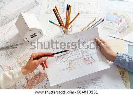 Interior Designers At Work interior designer works on hand drawing stock photo 135392420