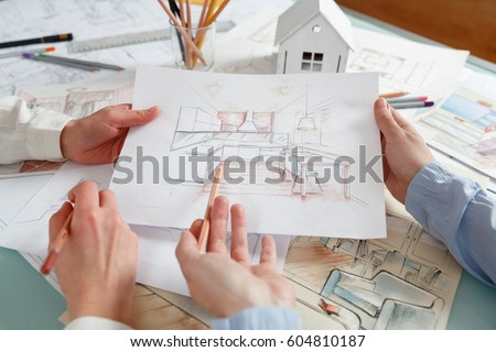 interior designers working on color hand stock photo royalty free 604810187 shutterstock - How Interior Designers Work