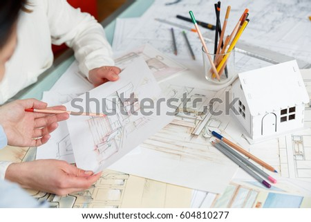 interior designers working on color hand stock photo 604810277 - How Interior Designers Work