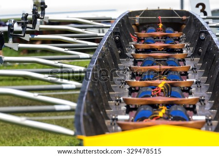 interior detail of a rowing boat scull for 8 rowers with repeating abstract pattern - stock photo