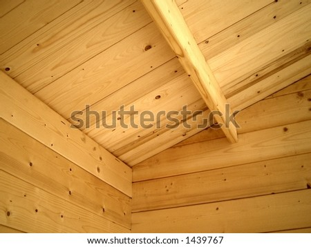 Interior detail of natural wood cabin - stock photo