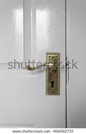 Interior door handle with lock