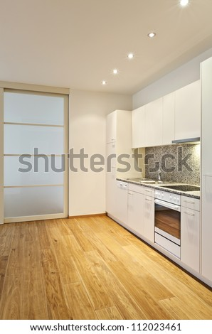 interior empty house with wooden floor, kitchen - stock photo