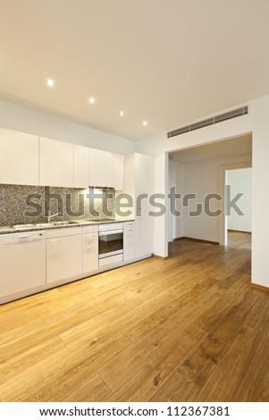 interior empty house with wooden floor, kitchen - stock photo