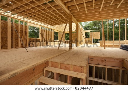 Interior framing of a new house under construction - stock photo