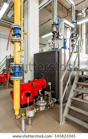 interior gas boiler room with a gas boiler and a gas burner