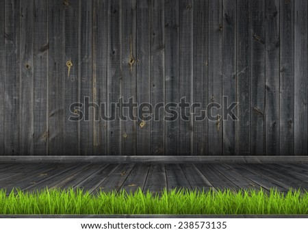 Interior. Grunge dark wood wall and floor with green grass, background texture.