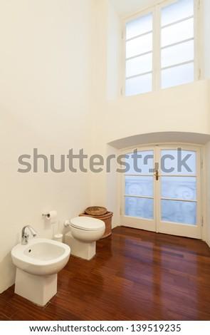 Interior hotel room, detail bathroom, bidet and toilet - stock photo