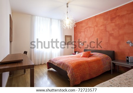 Interior house, bedroom red wall - stock photo