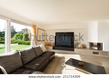 interior house, nice living room with leather sofa - stock photo