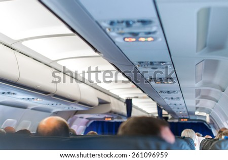 Interior inside of the plane with passengers. - stock photo