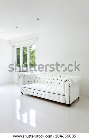 interior, leather sofa  in white room - stock photo