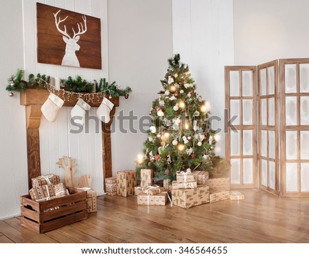 Interior living room with a Christmas tree and decorations. - stock photo