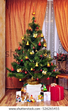 Interior living room with a Christmas tree and decorations. Winter holiday xmas theme. Happy New Year 2017. Merry christmas card.